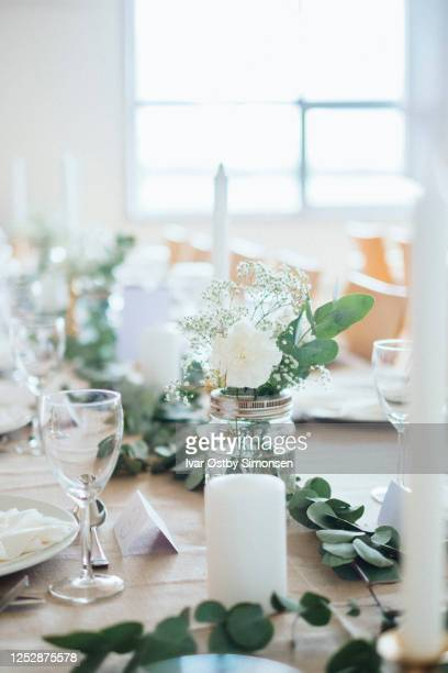 scandinavian style wedding decorated tables - wedding decoration stock pictures, royalty-free photos & images