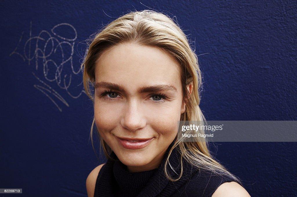 A Scandinavian woman against a blue background. : Stock Photo