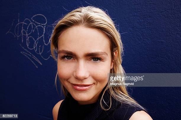 A Scandinavian woman against a blue background.