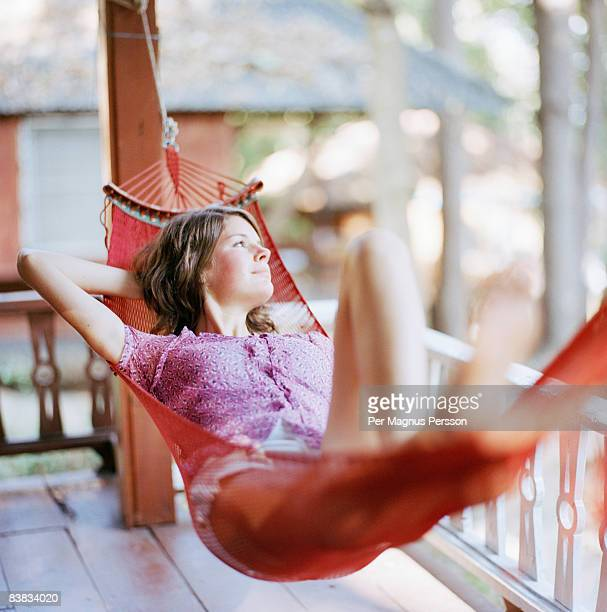 A Scandinavian woman laying in a hammock.