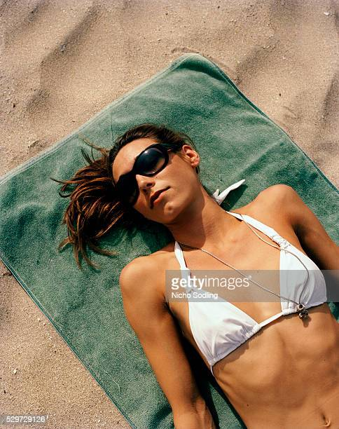 A Scandinavian woman laying sunbathing Thailand
