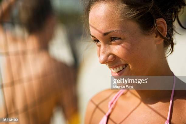 A Scandinavian woman playing beach volleyball.