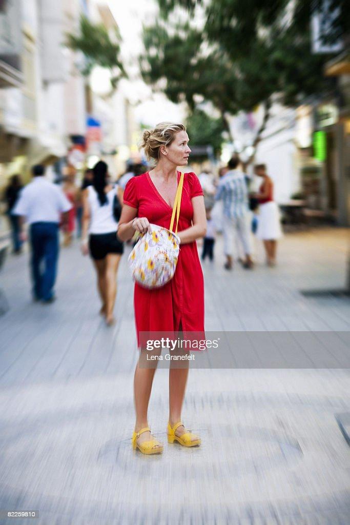 A Scandinavian woman standing in a street. : Stock-Foto