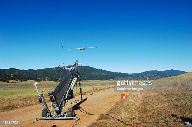 A ScanEagle unmanned aerial vehicle is launched from its catapult.