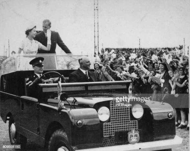 **Scanned from contact low-res** Queen Elizabeth II and the Duke of Edinburgh in an open top Land Rover in Newcastle, Australia.