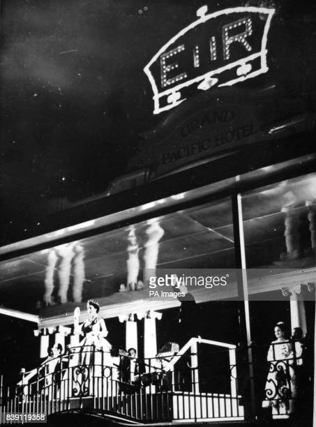 **Scanned lowres from contact** The Queen and Duke of Edinburgh wave from the balcony of the Grand Pacific Hotel in Suva Fiji to a crowd of Fijians...