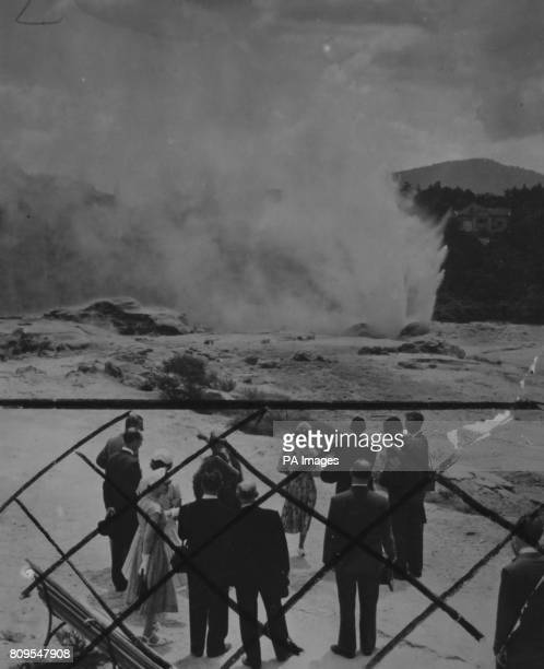 **Scanned lowres from contact** The Queen and the Duke of Edinburgh watch a geyser burst into steaming activity near the Maori village of...