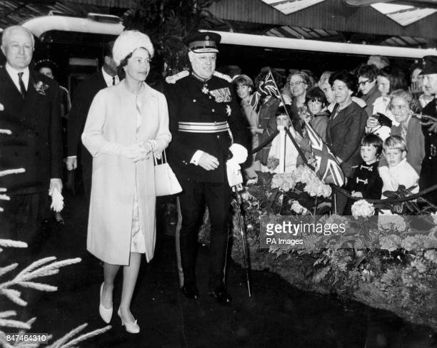 *Scanned lowres from print highres available on request* Queen Elizabeth II walking with Earl Spencer on her arrival at Kettering Railway Station at...