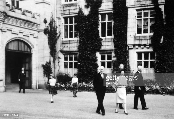 **Scanned lowres off contact** American President Dwight D Eisenhower walks with the Queen the Duke of Edinburgh Prince Charles and Princess Anne...