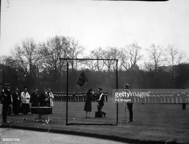 **Scanned lowres off contact** Queen Elizabeth II presents a heraldic flag known as a guidon to the 16th/5th Royal Lancers of which regiment she is...