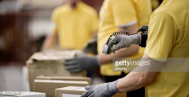 scanning boxes in warehouse - wearable computer stock pictures, royalty-free photos & images
