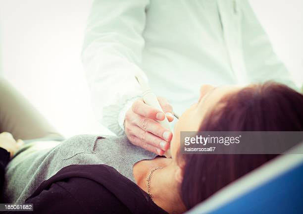 scanning of a thyroid - throat photos stock photos and pictures