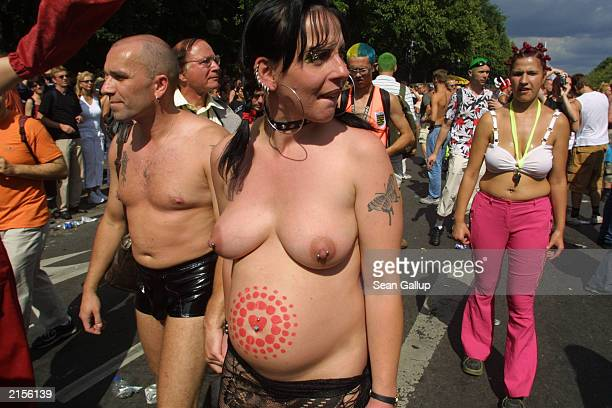 A scantily clad pregnant couple are among those attending the annual Love Parade July 12 2003 in Berlin Germany Hundreds of thousands of Techno fans...
