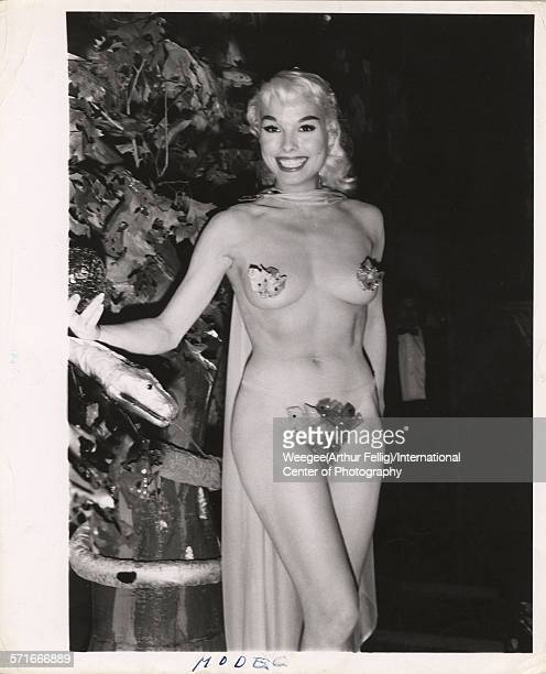 A scantily clad woman labelled 'Queen of the ball' by the original caption smiles circa 1950 Photo by Weegee /International Center of...