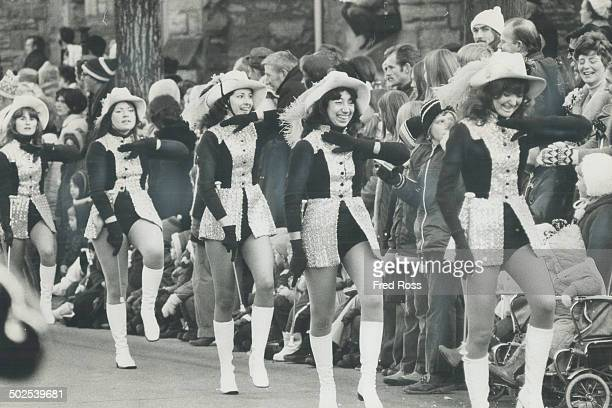 Scantily dressed majorettes were twirling and whirling to keep warm as Hamilton's Grey Cup parade wound along chilly streets