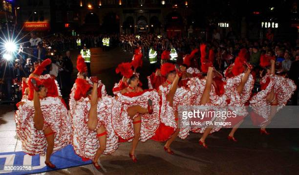 A scantilyclad troupe of cancan dancers from the Paris club Moulin Rouge performing outside Odeon Leicester Square in London for the royal premiere...