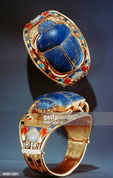 Scarab bracelet from Tutankhamun's tomb, 14th century BC. The tomb of the 18th Dynasty Ancient Egyptian Pharaoh Tutankhamun was discovered in 1922 by...