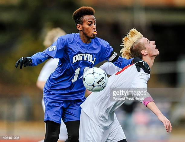 Scarborough defender Spencer Pettingill and Lewiston striker Abdi ShariffHassan fight for the ball at Fitzpatrick Stadium in Portland ME on Saturday...
