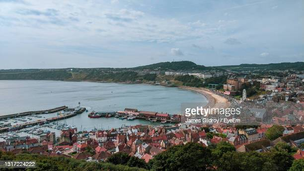 scarborough harbor. high view of river amidst buildings in city - coastline stock pictures, royalty-free photos & images