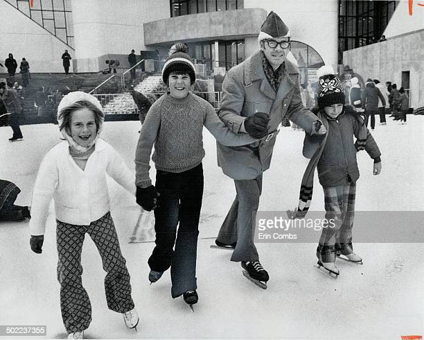 Scarborough Mayor Paul Cosgrove and some small friends Robin Fulton brother Chris and Denine Faubertofficially open the skating rink in Albert...