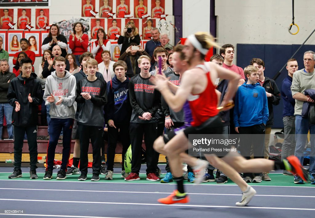 Scarborough track team members and fans cheer during the 4x200 meter relay during the Maine Class A Track and Field Championship Monday, Feb. 19, 2018 in Gorham, Maine.