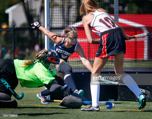 Scarborough vs Westbrook field hockey Emma Ranco and Kimmie Goddard left of Westbrook try to block a shot by Kelby Woolverton of Scarborough in the...