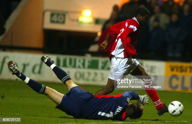 Scarborough's Bimbo Fatokun takes the ball past Cambridge Utd Goalkeeper Shaun Marshall in the last minutes of extra time in the FA Cup First Round...