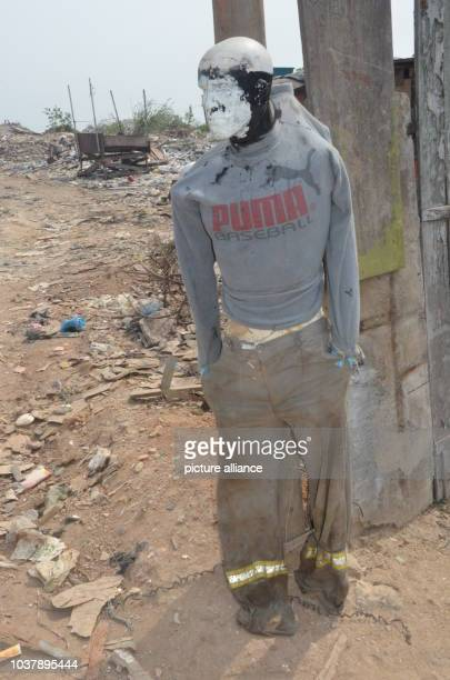 A scarecrow at the entrance of an illegal waste dump controlled by a criminal mafia in the district of Gramacho of Rio de Janeiro Brazil 9 July 2016...