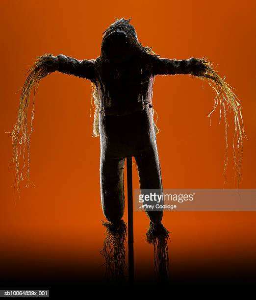 Scarecrow figurine with straw arms
