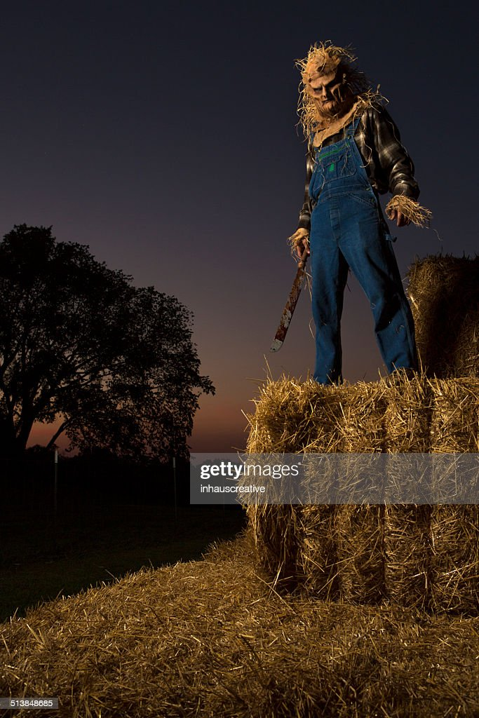 scarecrow holding a hatchet stock photo getty images