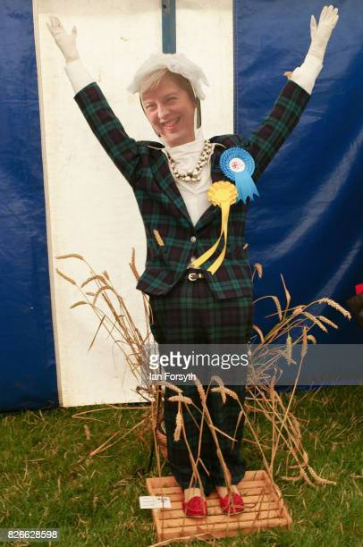A scarecrow of Prime Minister Theresa May is one of the exhibits during the Osmotherley Country Show on August 5 2017 in Osmotherley England The...