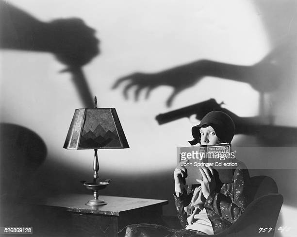 Scared actress Jean Arthur holds a book for a publicity still for the 1929 mystery film The Greene Murder Case in which she stars as character Ada...