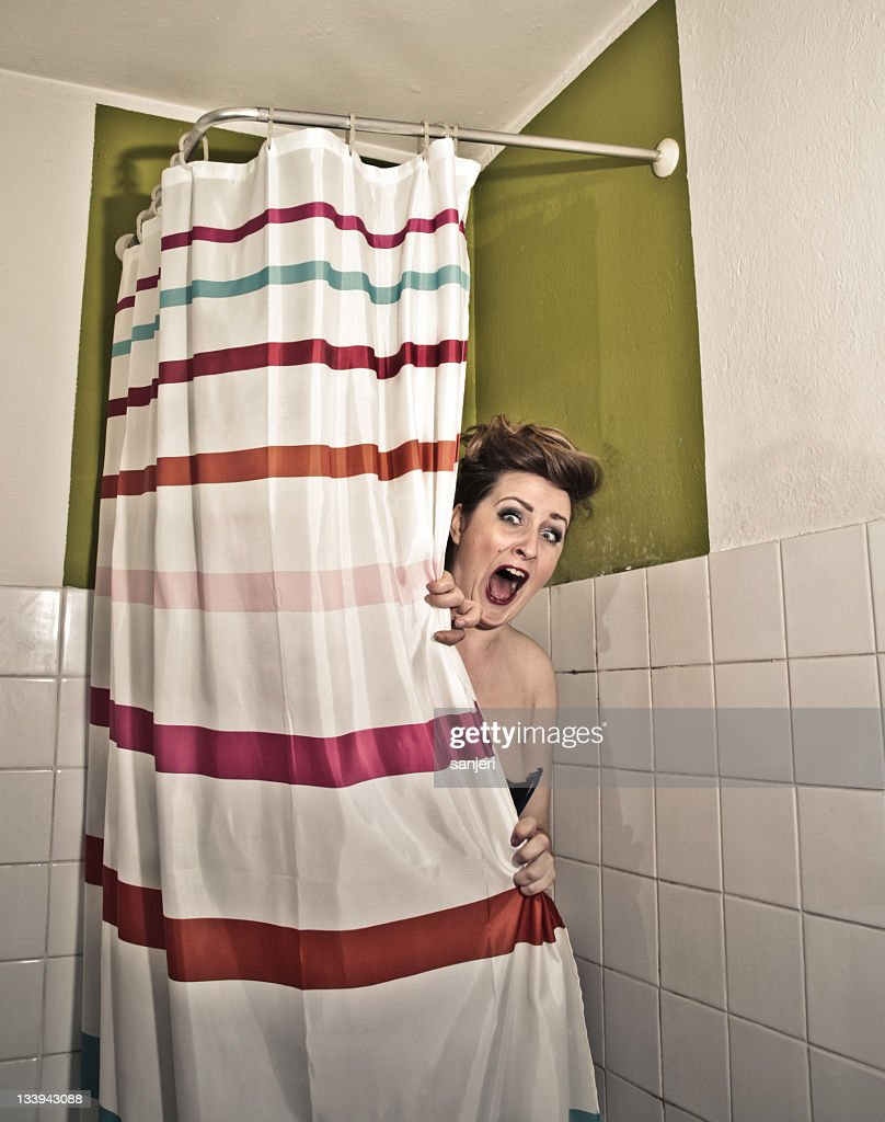 frightened-woman-in-the-shower