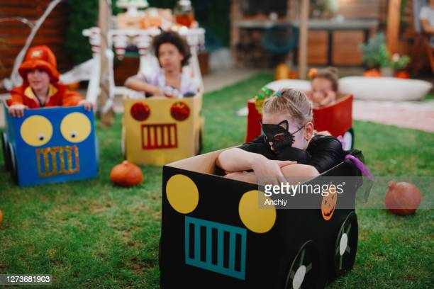 scared little grill watching movie from cardboard box car. movie night - scaredastronaut stock pictures, royalty-free photos & images