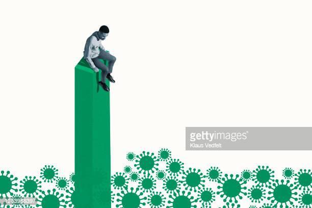 scared man on green column looking at coronavirus - stress coronavirus stock pictures, royalty-free photos & images