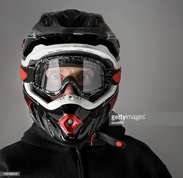 Scared Motocross Motorbike Rider with Enduro Helmet