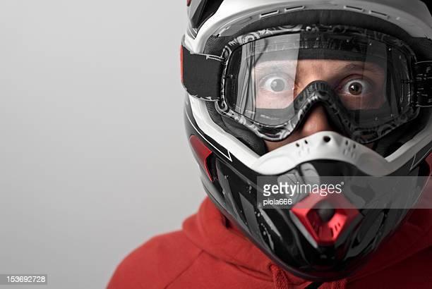 Scared Motocross Motorbike Rider with Helmet