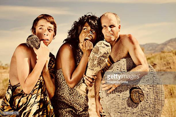 scared prehistoric cavemen - caveman stock pictures, royalty-free photos & images