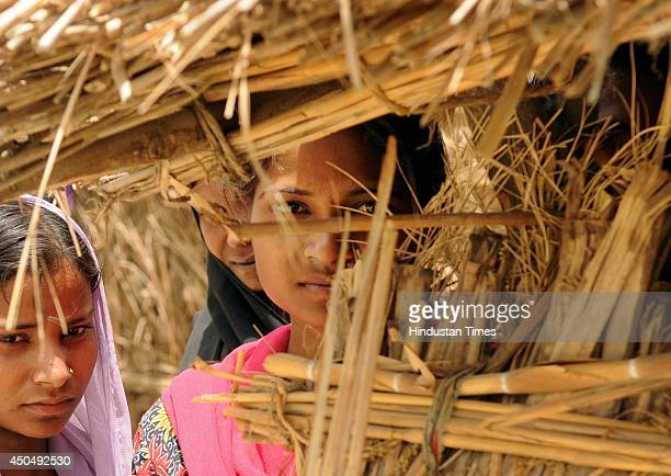 Scared villagers in Lonianpurwa where seminude body of the 45 year old woman belonging to a backward caste was found hanging with a saree from a...