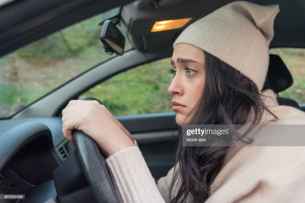 Scared woman driver in car. Inexperienced anxious motorist : Stock Photo