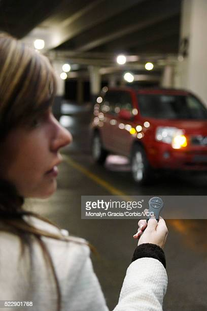 Scared woman in a parking lot
