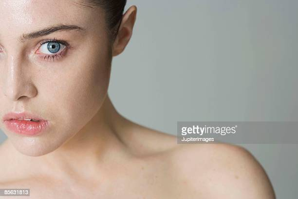 Scared woman with bare shoulders