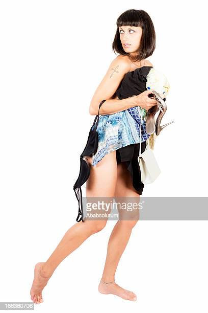 Scared Woman with Pile of Clothes Running