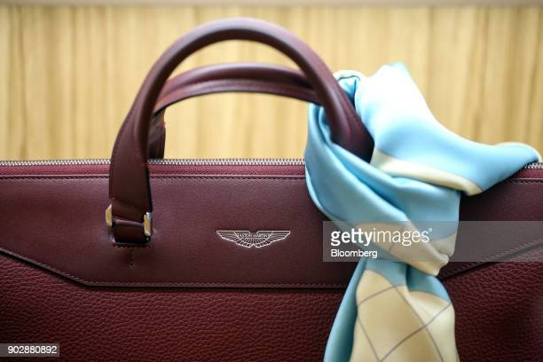 A scarf hangs around the handle of a ladies handbag on display during the launch event for the 'Aston Martin at No 8 Dover Street' luxury brand...