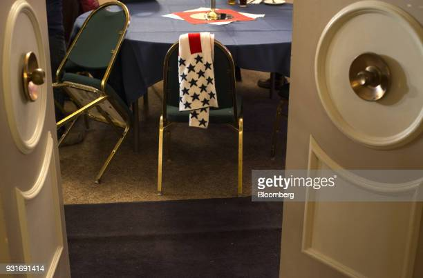 A scarf lies over the back of a chair ahead of an election night rally with Rick Saccone Republican candidate for the US House of Representatives not...