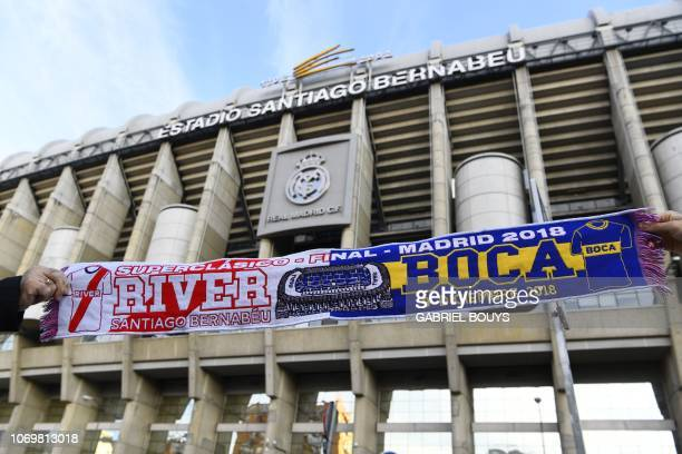 A scarf of River Plate and Boca Juniors football teams is displayed in front of the Santiago Bernabeu stadium in Madrid on December 8 on the eve of...
