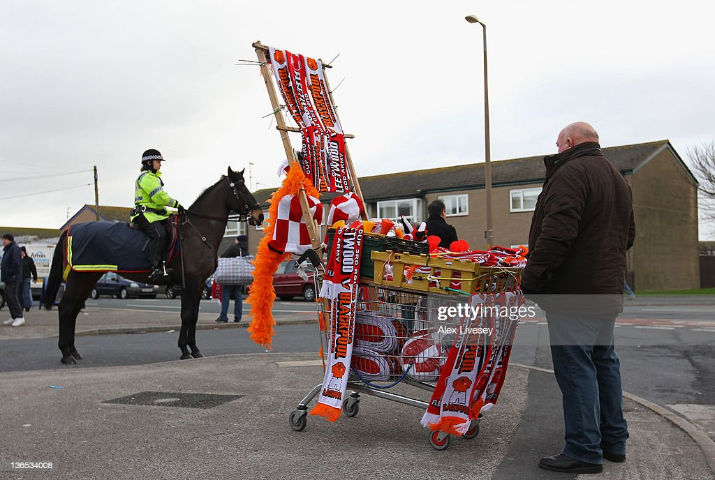 A scarf seller is seen outside the Highbury Stadium prior to the FA Cup sponsored by Budweiser third round match between Fleetwood Town and Blackpool at Highbury Stadium on January 7, 2012 in Fleetwood, England.