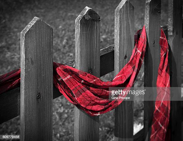 A scarf woven to a fence.