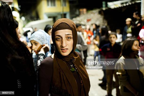 Scarfed young woman enjoys a wedding party in the district Tarlabasi on May 14, 2006 in Istanbul, Turkey. Tarlabasi is a neighbourhood in the Beyoglu...