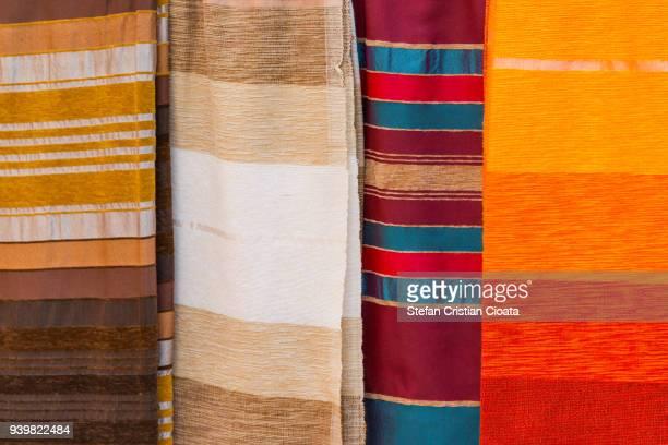 scarfs for sale in ksar of ait-ben-haddou, morocco, africa - foulard accessoire vestimentaire pour le cou photos et images de collection